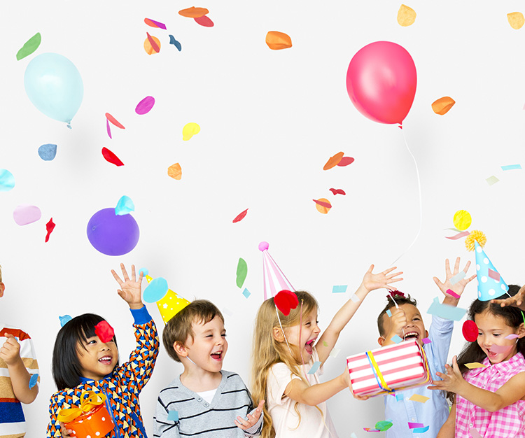 Group of kids celebrate birthday party together with presents, confetti and balloons
