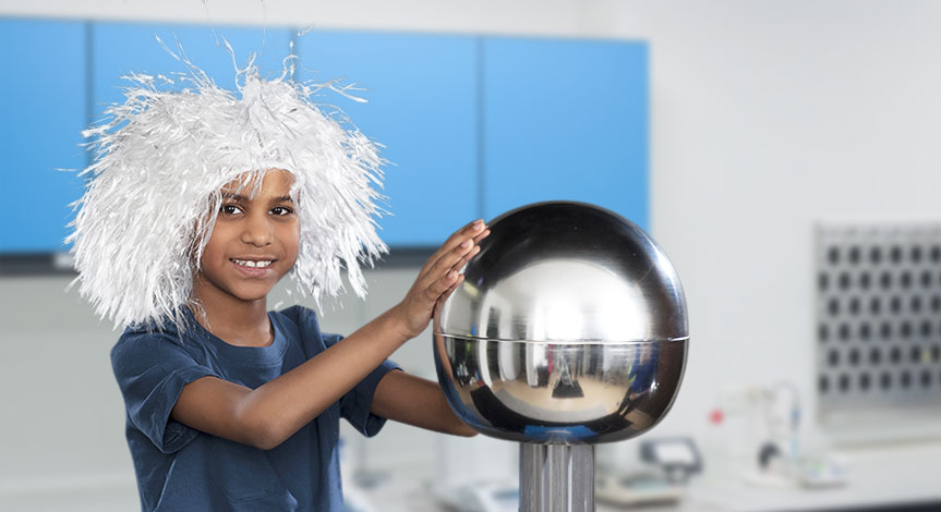 Kid with white hair touching electro ball causing his hair to stand in the air.
